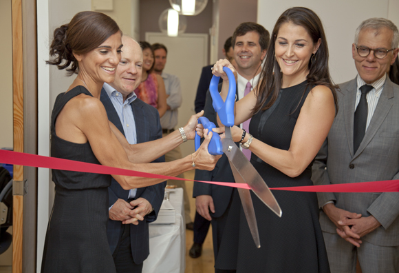 Dr. Sheeva Talebian and Dr. Jaime Knopman cutting the ribbon of the new clinic.