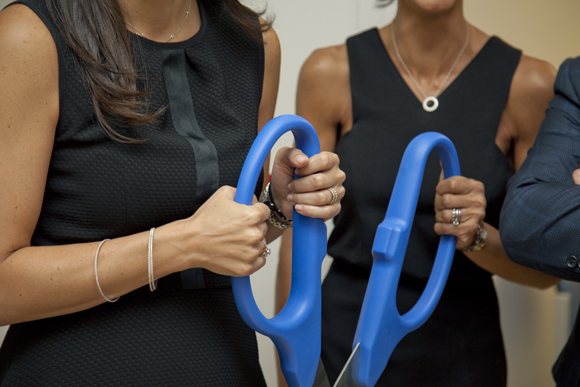 Dr. Sheeva Talebian and Dr. Jaime Knopman preparing to cut the ribbon of the new clinic.