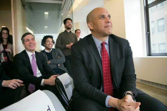 Sen. Booker listens to a speech during the unveiling