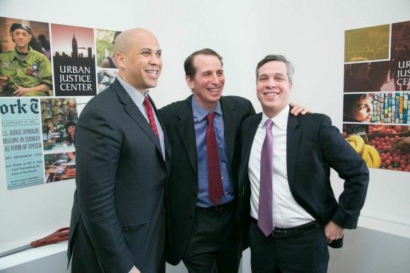 Sen. Cory Booker, UJC Founder Doug Lasdon and General Counsel to the U.S. Treasury Department Christopher Meade pose for a photo.