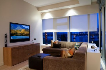 Marvelous-Lutron-Electronics-vogue-Vancouver-Contemporary-Family-Room-Decoration-ideas-with-accent-lighting-beige-ceiling-beige-wall-blinds-brown-sectional-brown-sofa-city-view-cityscape