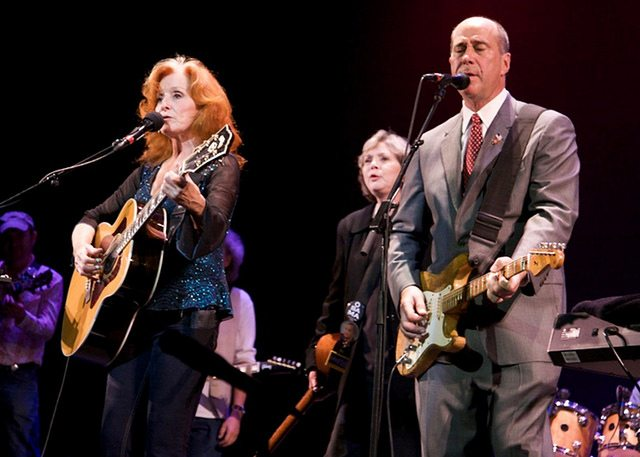 John Hall on-stage with Bonnie Raitt